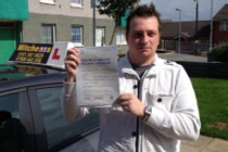 Russel had driving lessons in Ashton -U-Lyne.